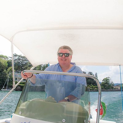 Gary at the helm of our powerboat for the day on Lake Como, Italy