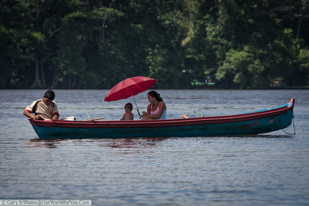 A family on a boat in the Lagoon in Tortuguero, Costa Rica