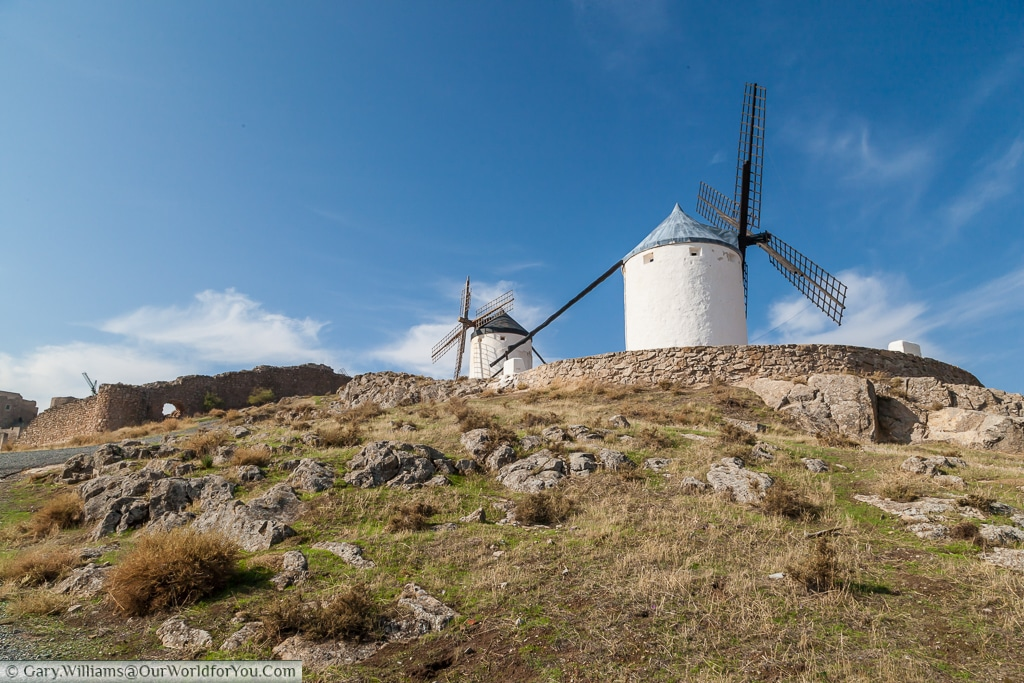 A pair of windmills pearched high-up the hill in Consuegra, La Mancha, Spain