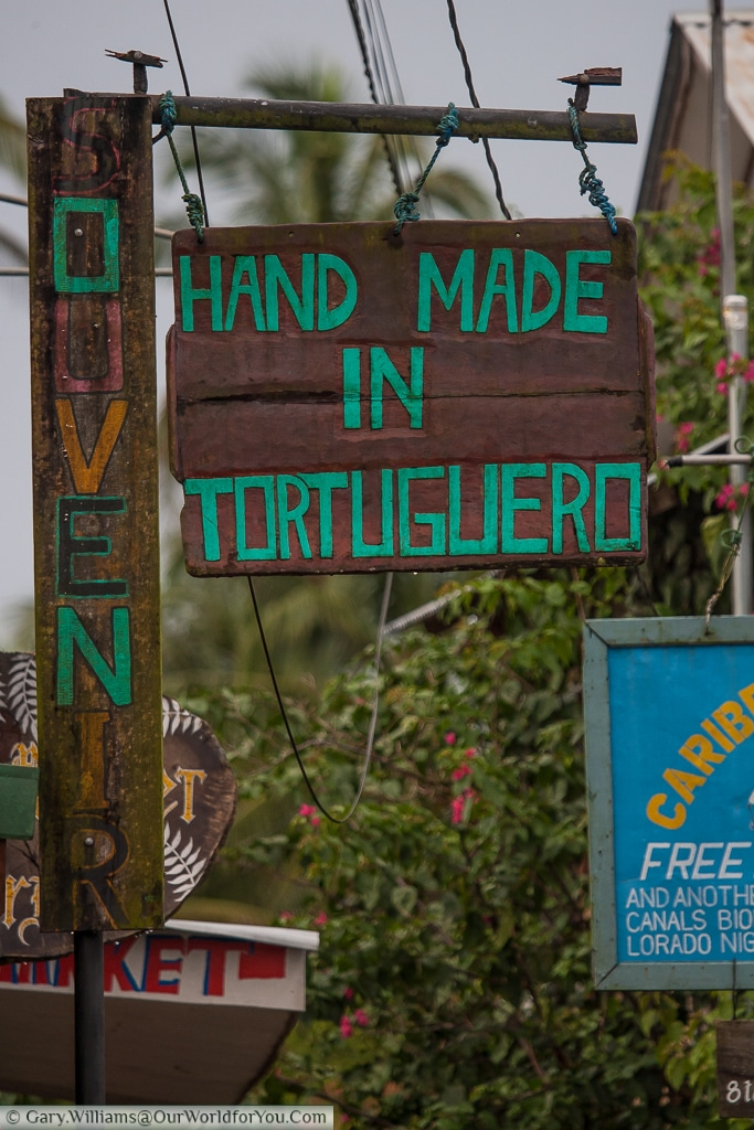A small sign declaring 'Hand Made in Tortuguero'.  I guess it's a gift shop, Costa Rica