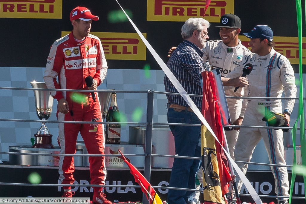 Lewis Hamilton, Felipe Massa, Sebastian Vettel & George Lucas, on the podium at the end of the 2015 Italian Grand Prix in Monza, Italy