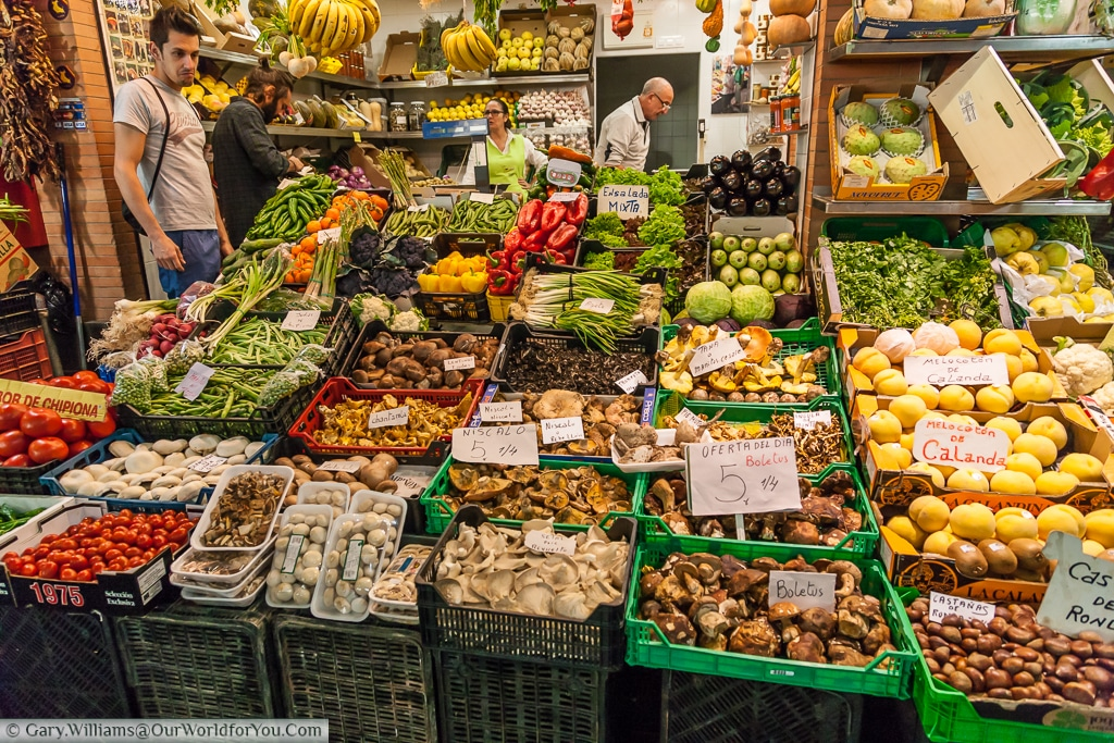A grocer's stall in the Mercado de Triana, Seville, Spain