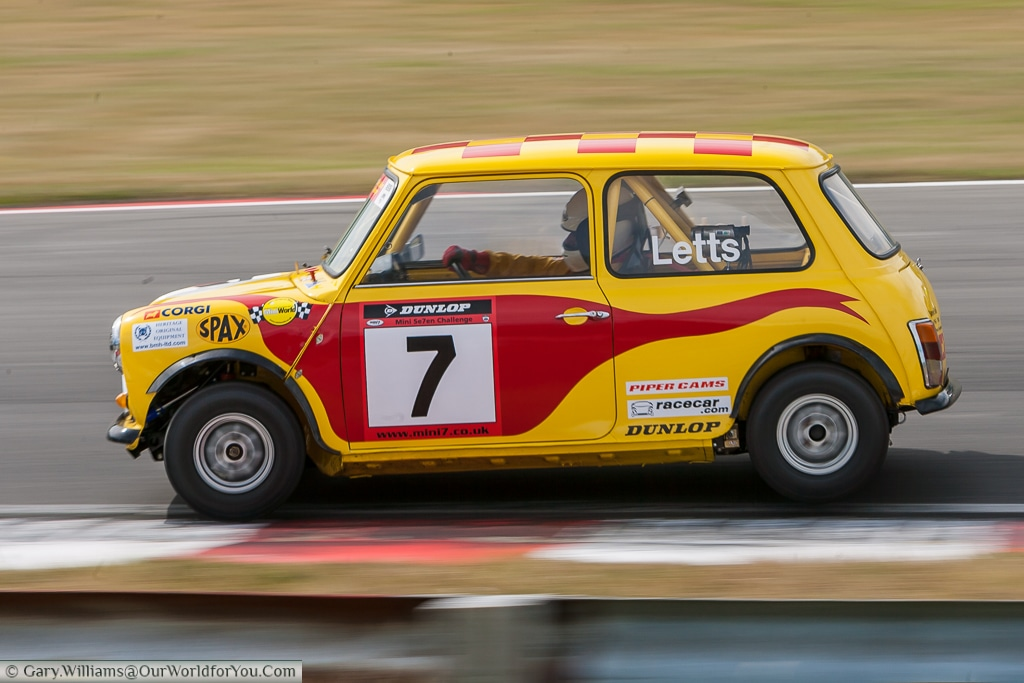 A racing Mini blasting around Brands Hatch in 2007.