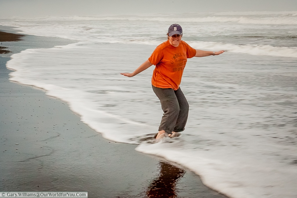 Janis dipping her toes in the Caribbean Ocean at Tortuguero, Costa Rica
