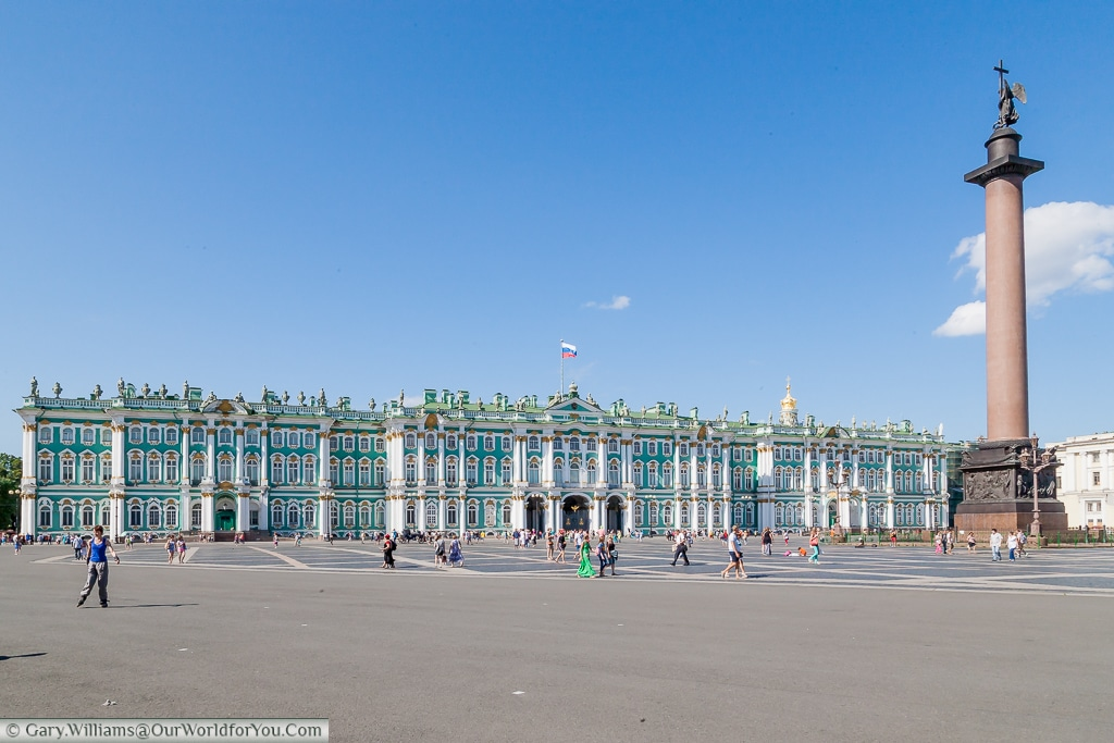 A view across Palace Square to the Hermitage Museum, with the Alexander Column on the right, St Petersburg, Russia