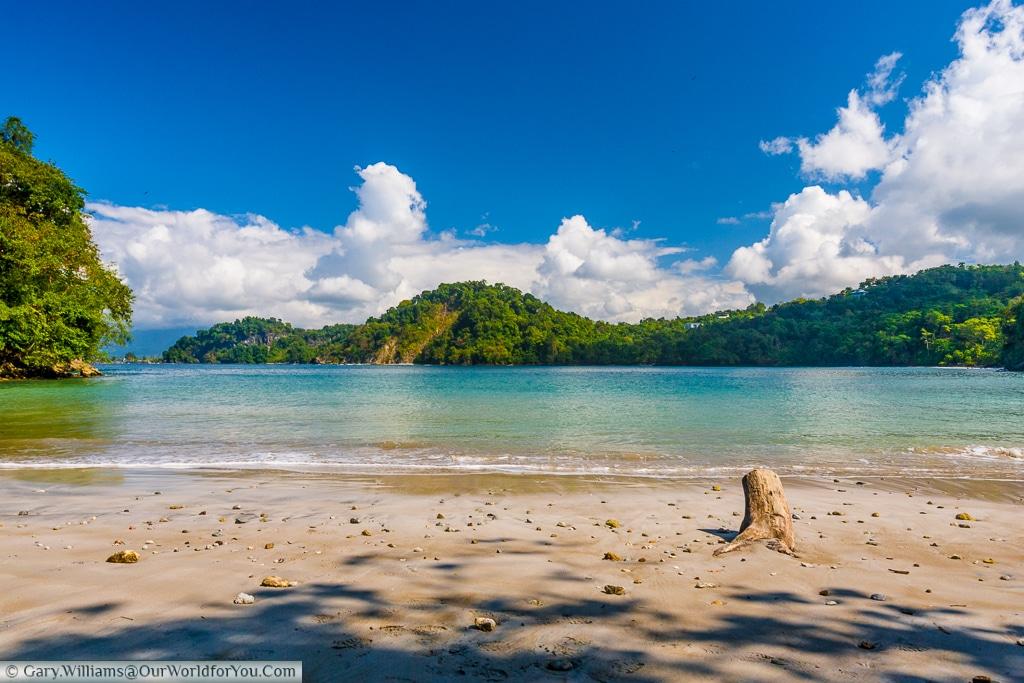 A very quiet beach, set in a bay in Manuel Antonio, Costa Rica
