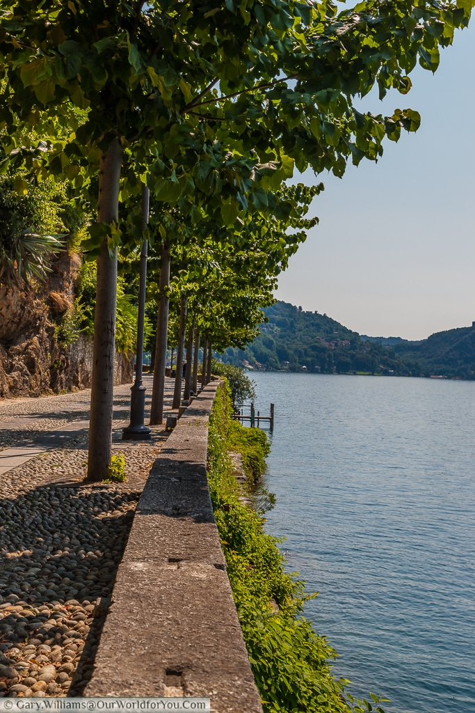 The tree lined Via Giovanetti, Orta San Giulio , Lake Orta, Italy