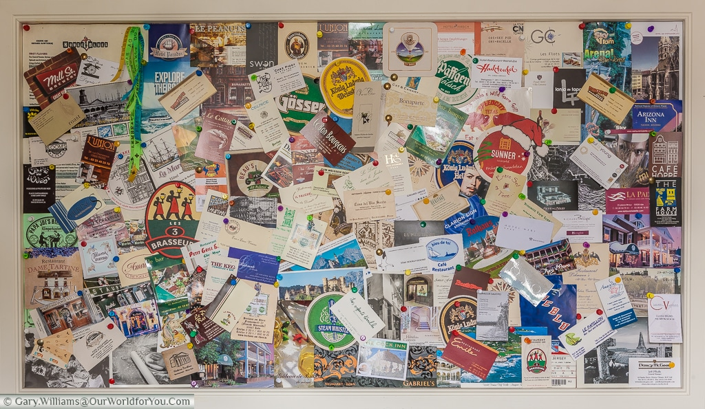 The 'Memories Board' in our kitchen, a constant reminder of our travels when we are at home.