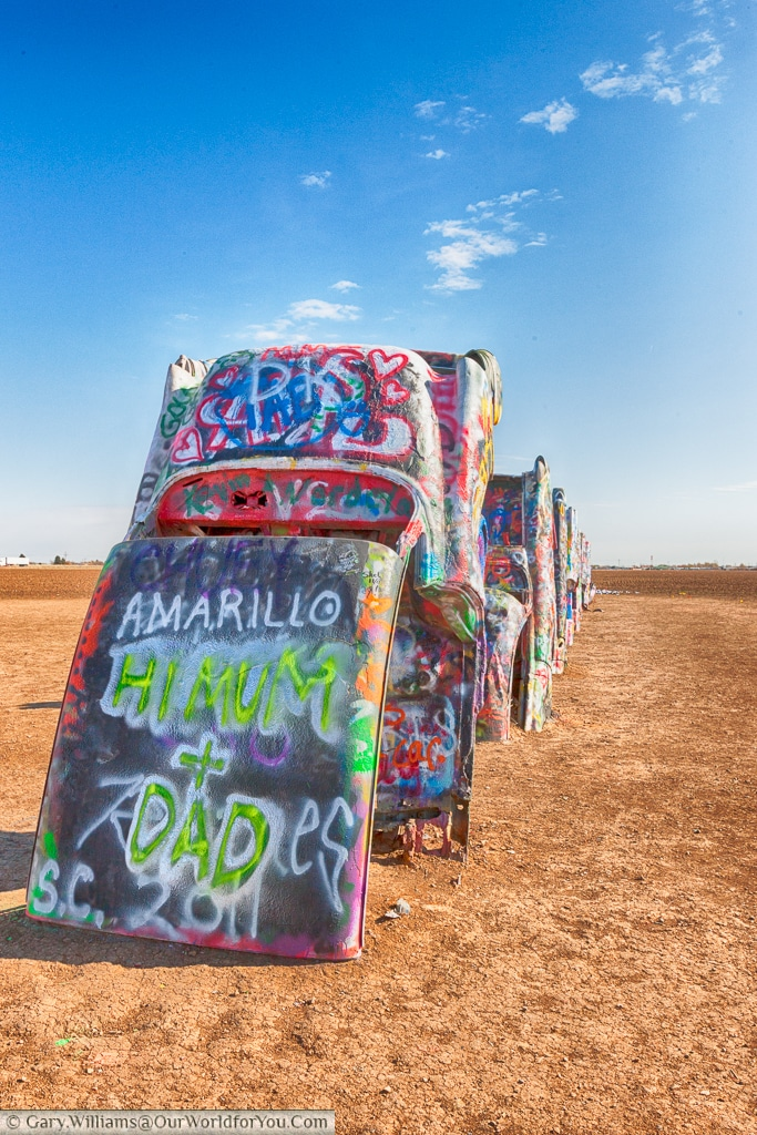 A postcard to loved ones at the Cadillac Ranch, Amarillo, Texas