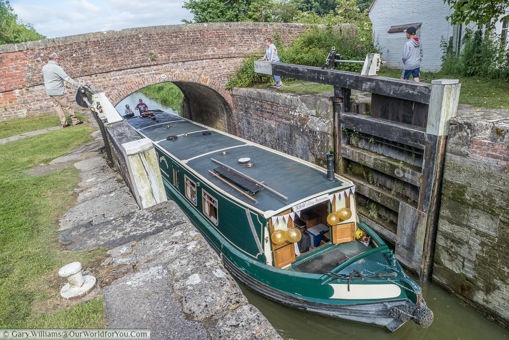 Moonbeam enters a lock on the Kennet & Avon Canal, England, United Kingdom