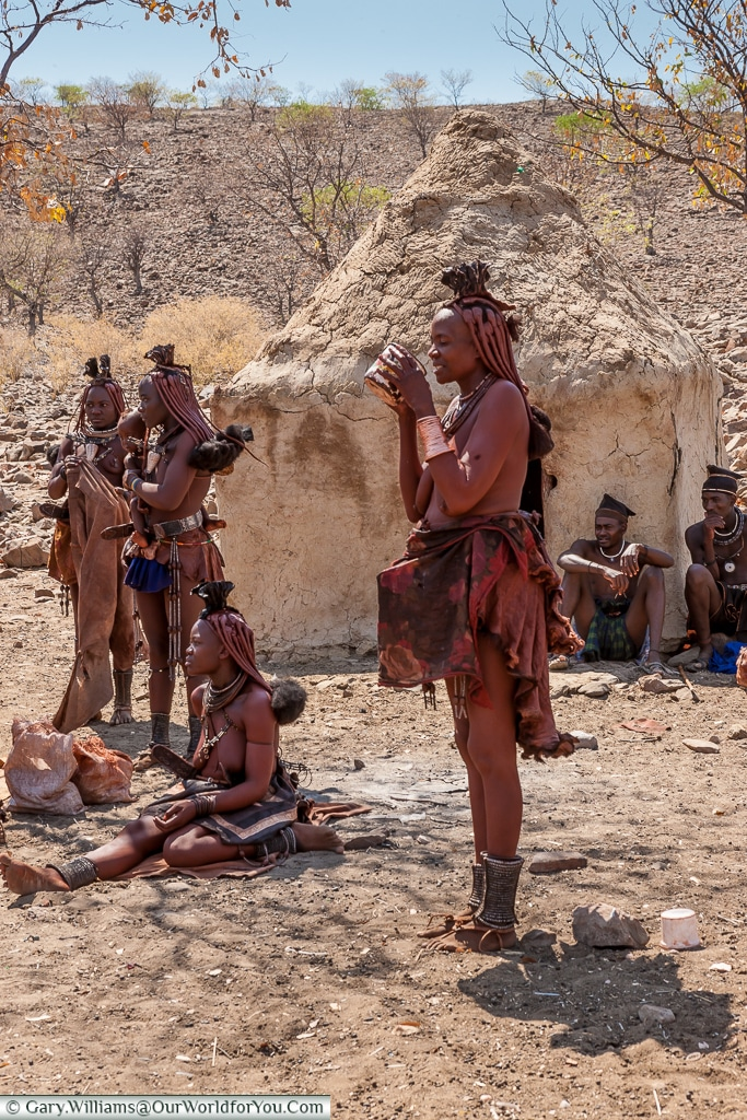 Taking a drink, the Himba tribe, Damaraland, Namibia