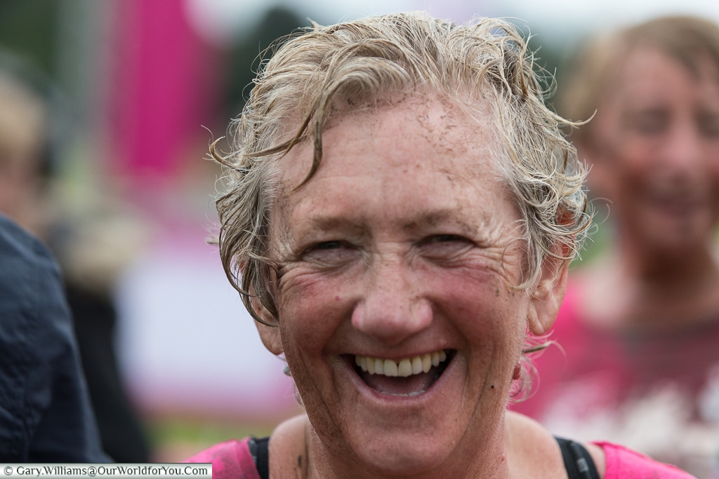 The joy at completing the Pretty Muddy Cancer Research event, Cardiff, UK