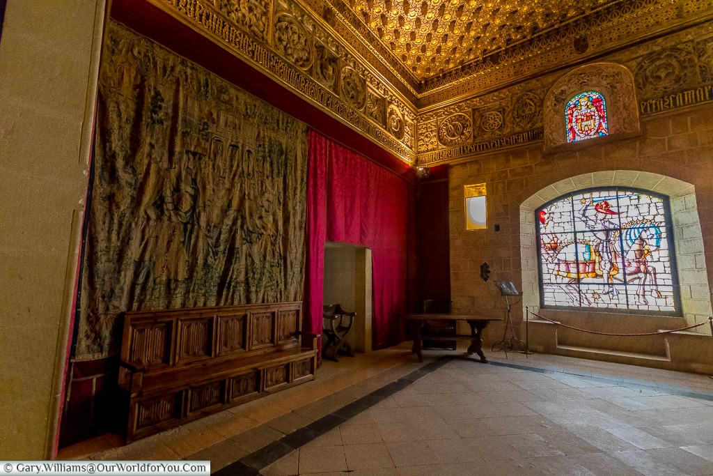 A tapestry & stained glass window in the Pine Cone Room, Alcáz