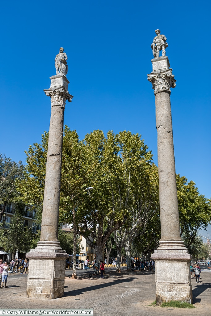 Two columns stand at one end of Alameda de Hércules, Seville, Spain